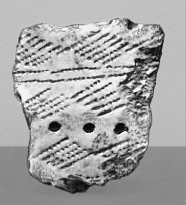 Фрагмент глиняного сосуда (лесная полоса Европейской части СССР). Эпоха неолита. Орнамент.