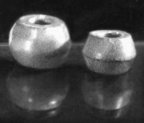 Шиферные пряслица 11—13 вв., найденные в Новгороде. Пряслице.