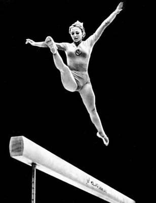 Спортивная гимнастика. Упражнения на бревне (Н. А. Кучинская). Спортивная гимнастика.
